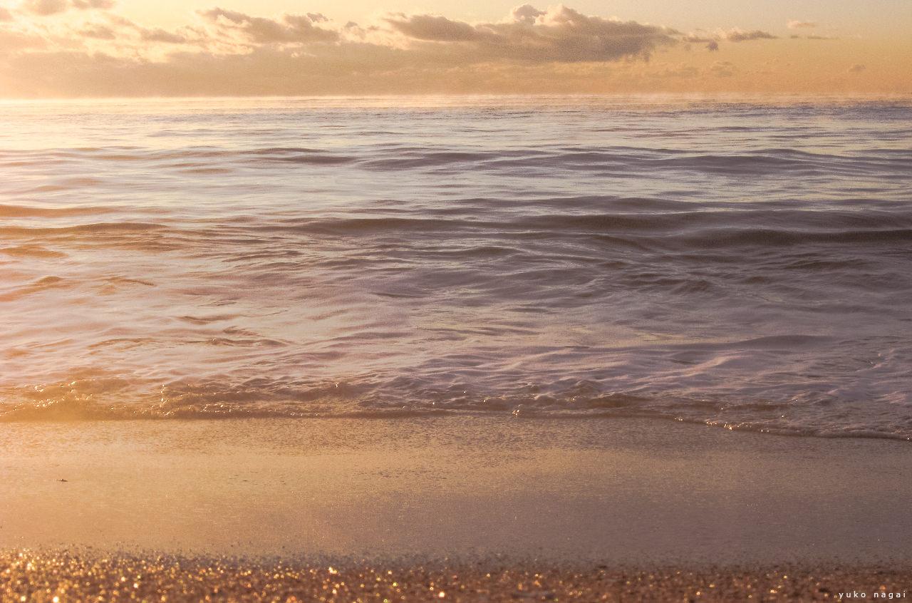 Sea shore at sunrise.