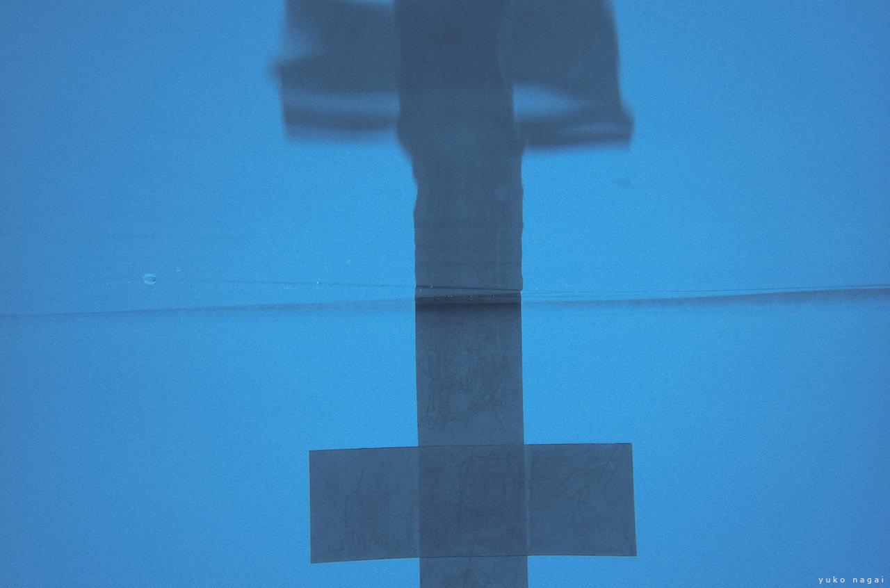 Swimming pool geometrical cross pattern.
