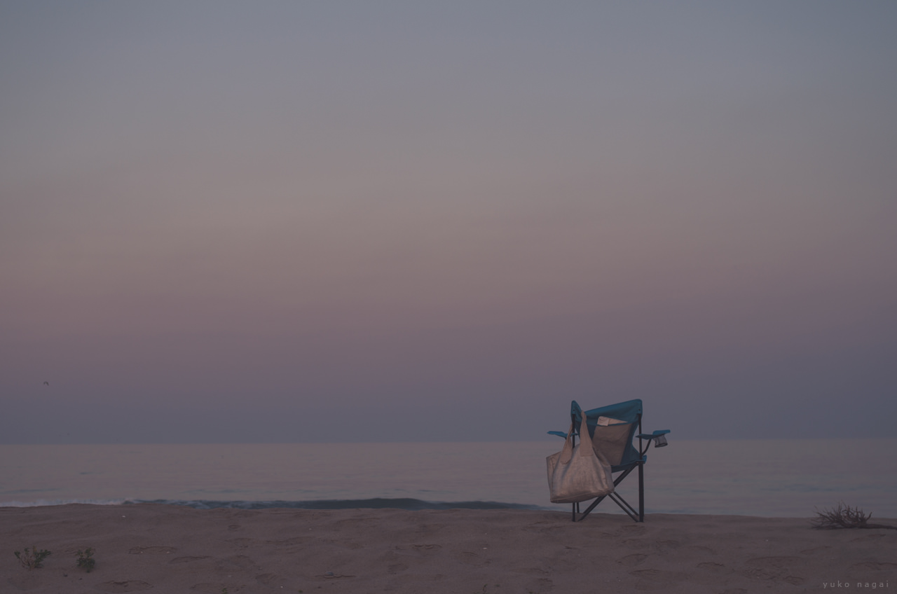 A chair on sunset shore.