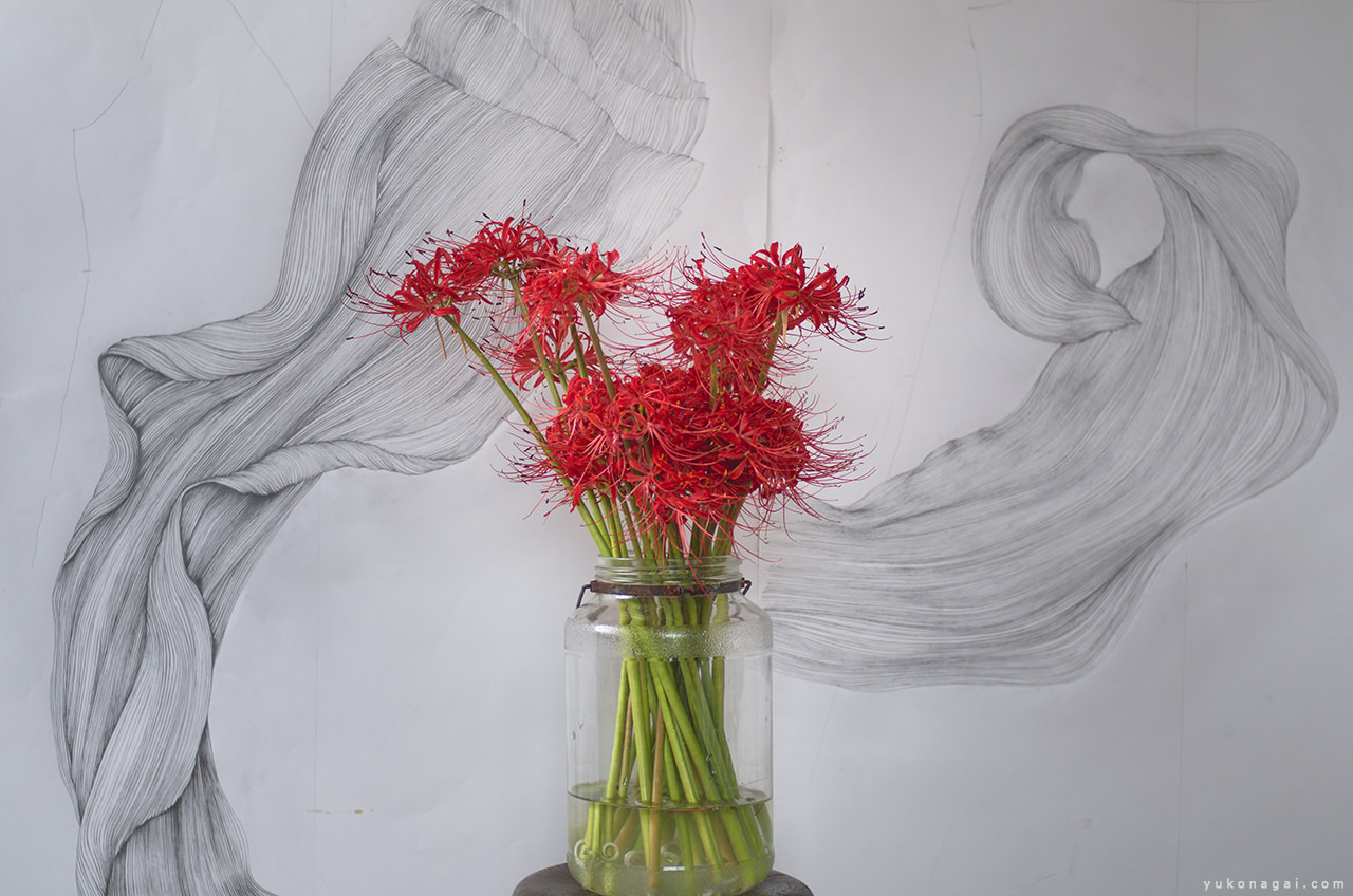 Art works in studio with a lily bouquet.