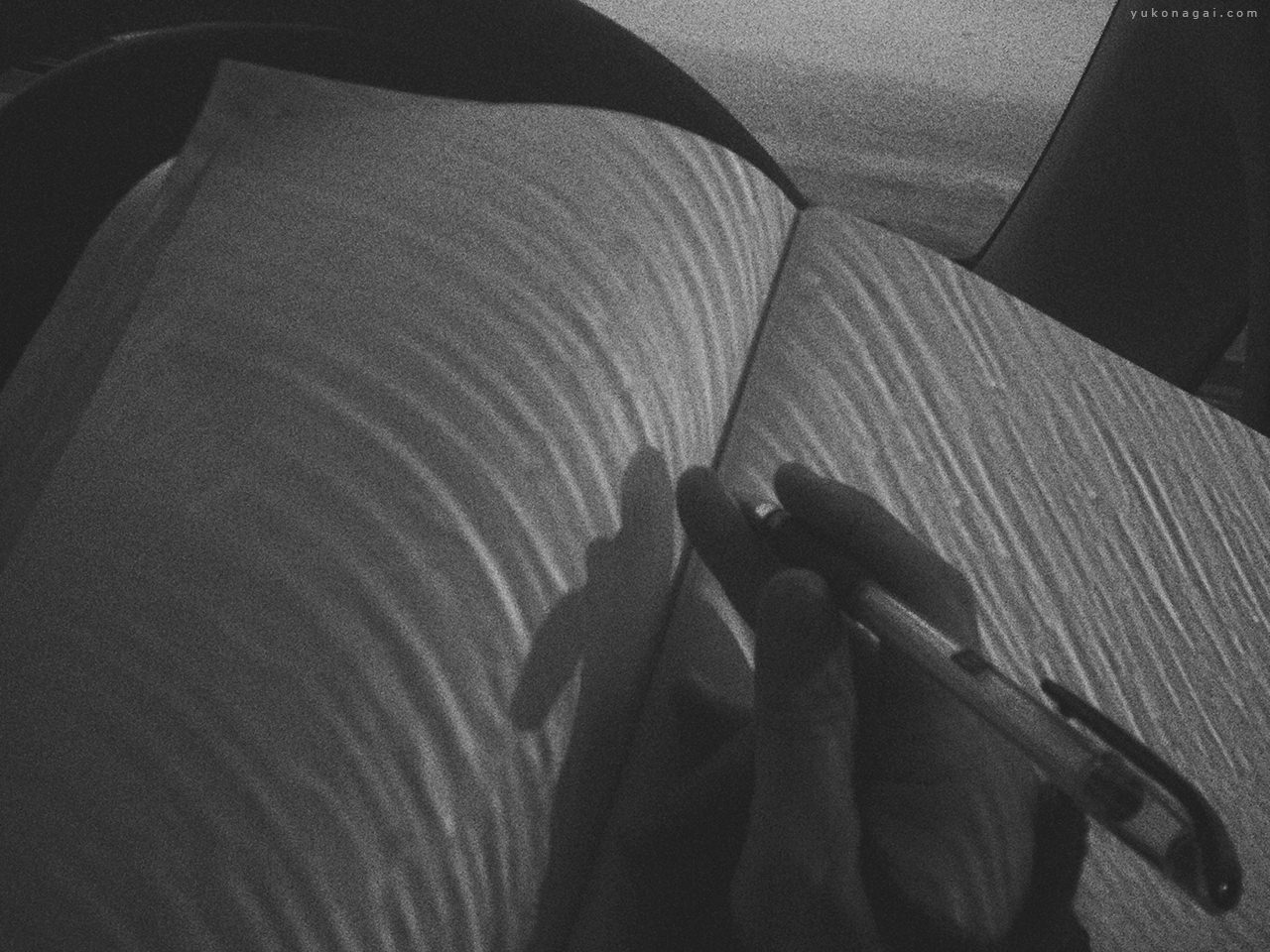 Windshield rain shadows on a journal.