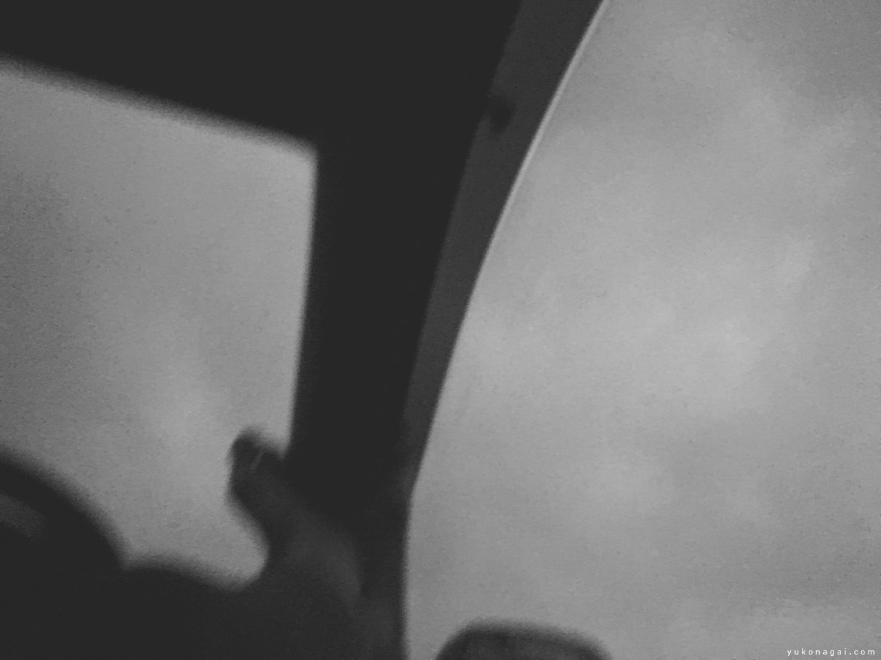 Cloudy sky through a driver seat.