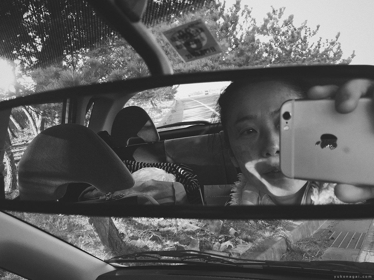 A rear view mirror self portrait.
