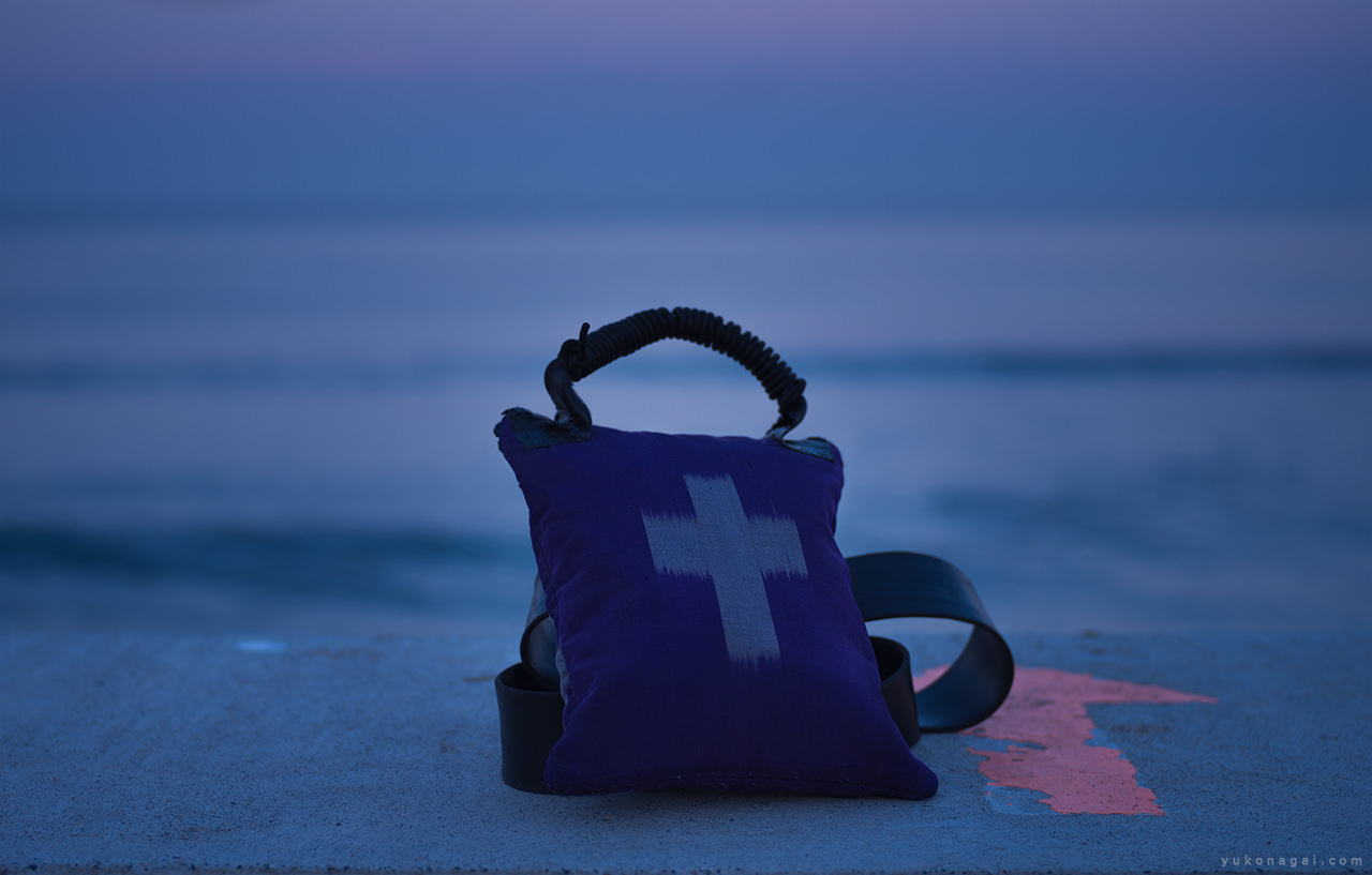 A small pouch by the sunset sea.