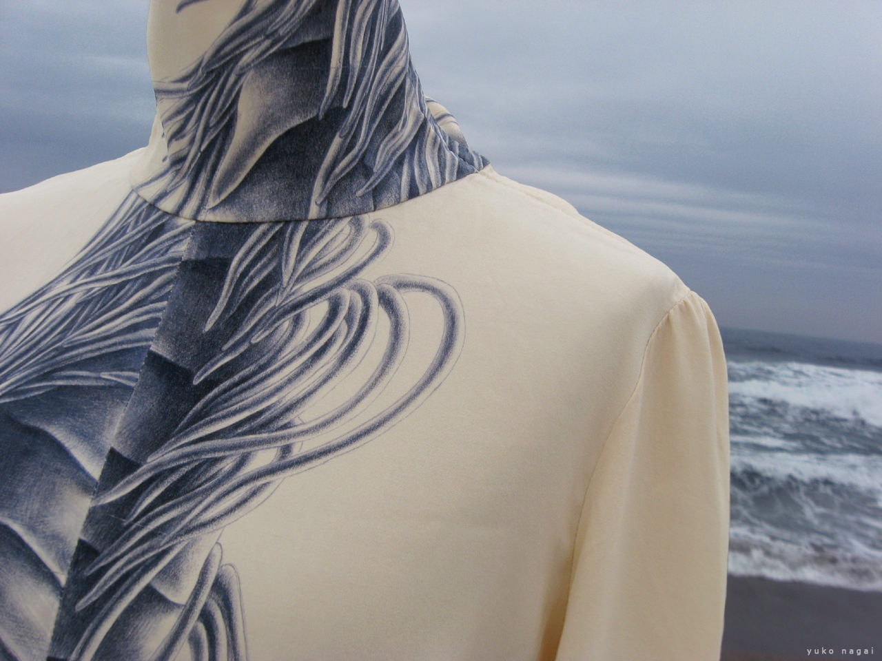 A hand painted blouse on the beach.