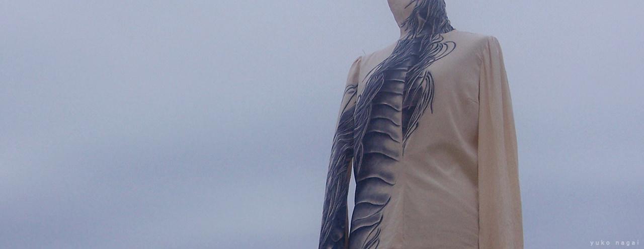 Dragon silk blouse on the beach.