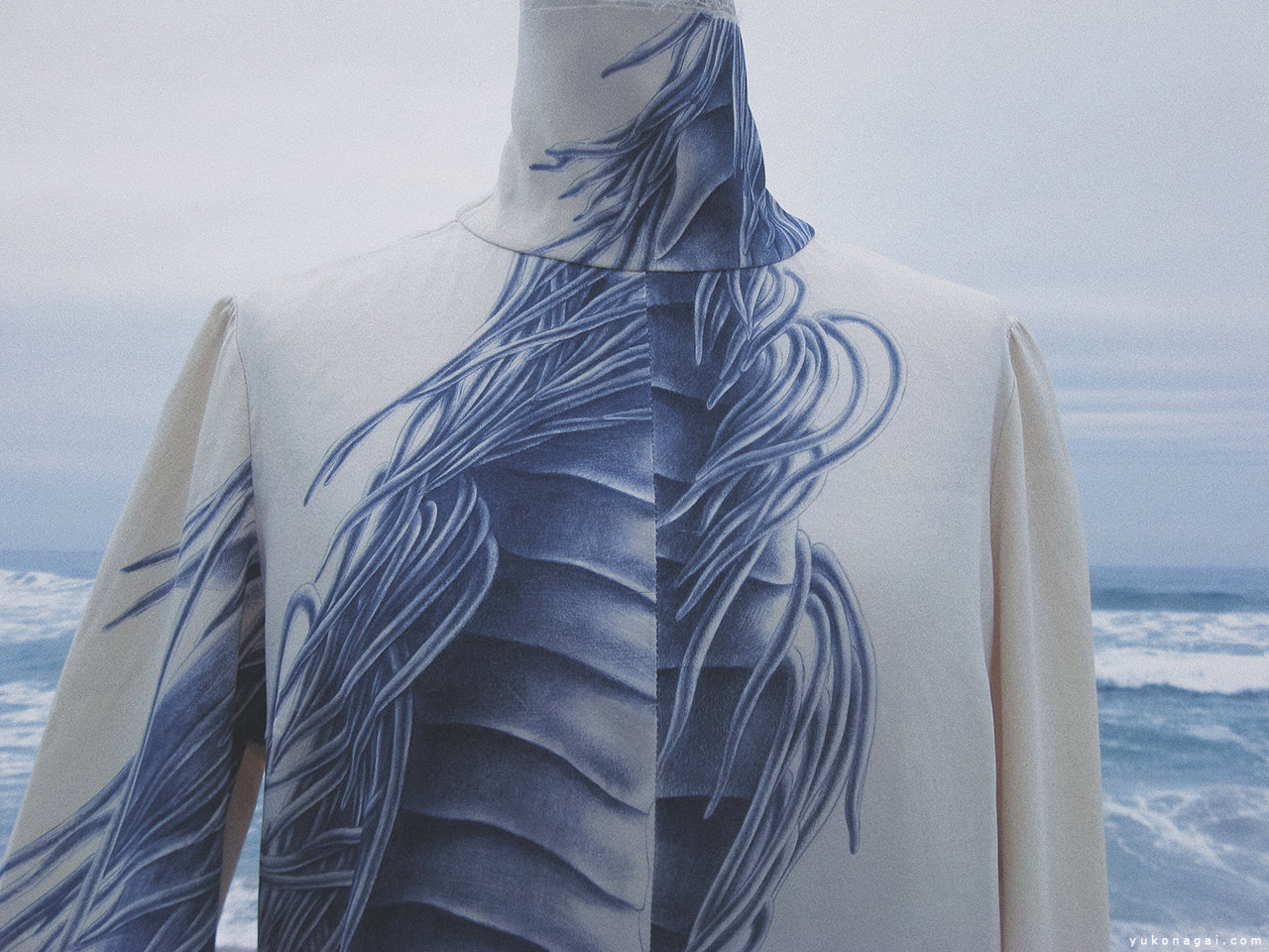 A silk blouse with dragon painting on the beach.