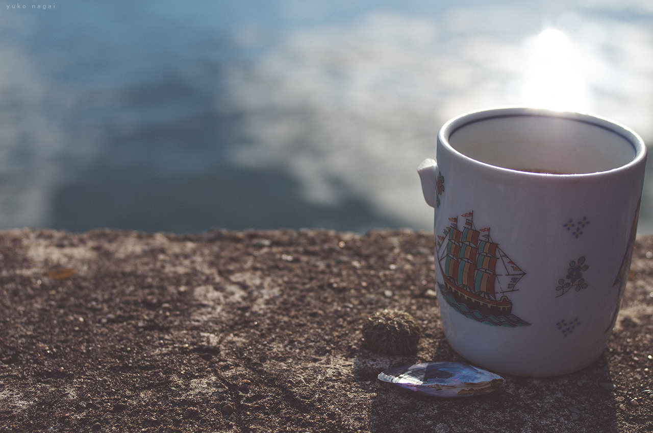 A coffee cup at a port.