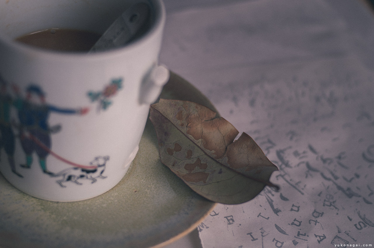 Coffee cup with a leaf.