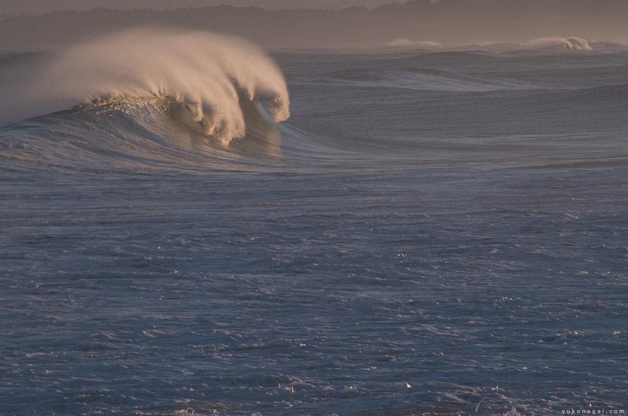 Ocean waves at sunset.