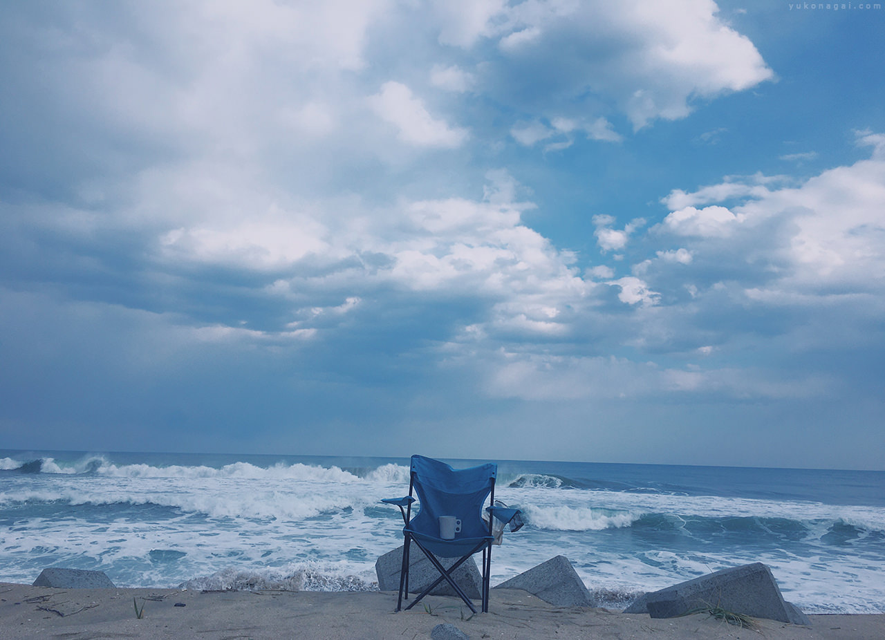 Sea shore with a chair.
