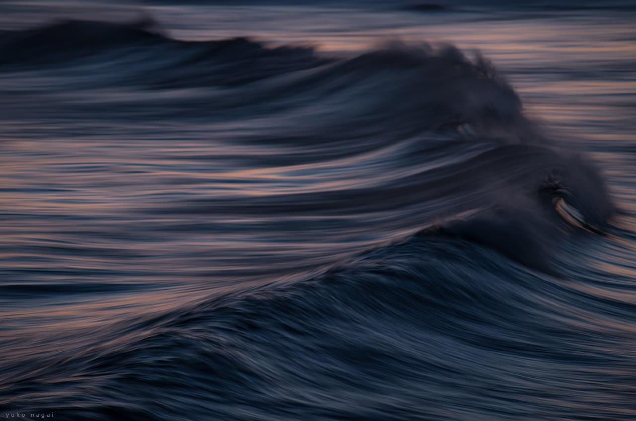 A wave at sun down.