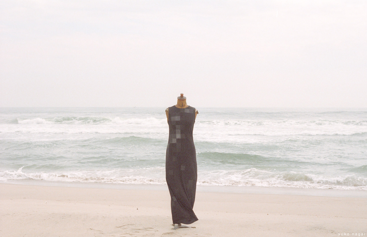 A hand painted dress on the beach.