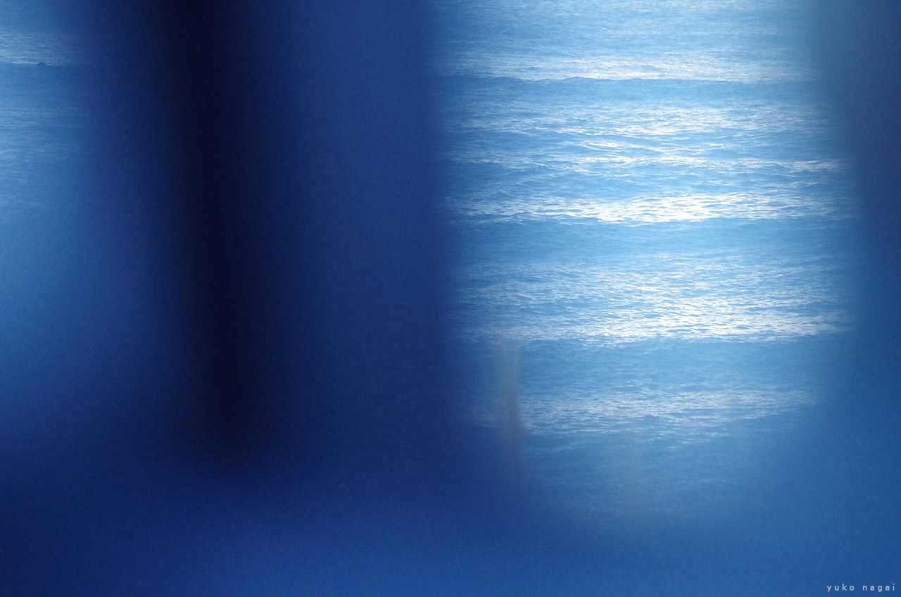 Ocean from a car window.