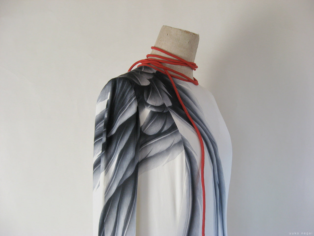 A wing painting on a dress.