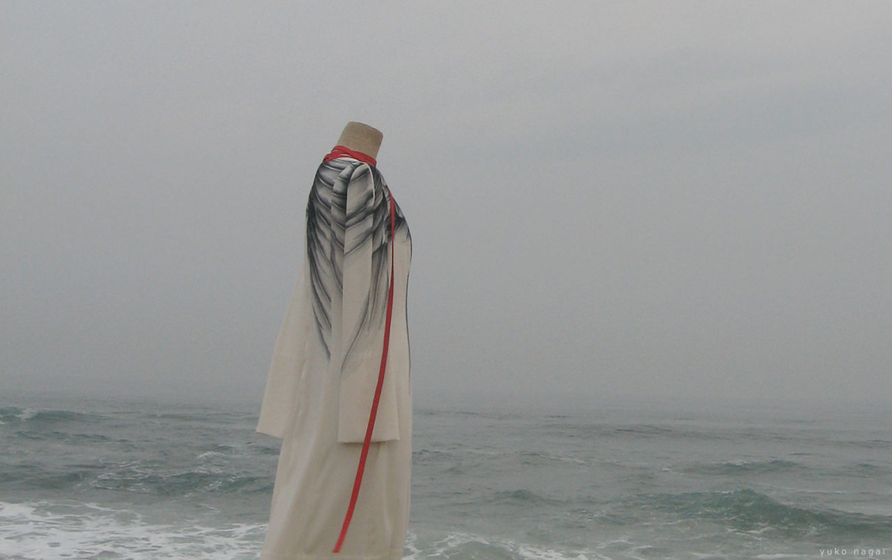 A hand painted dress at the shore.