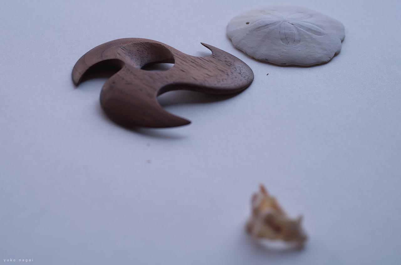 A wood carving and natural objects.