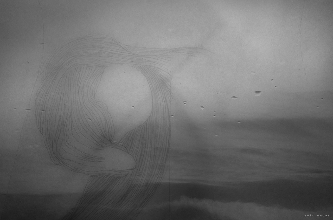 An abstract pencil drawing over ocean waves.