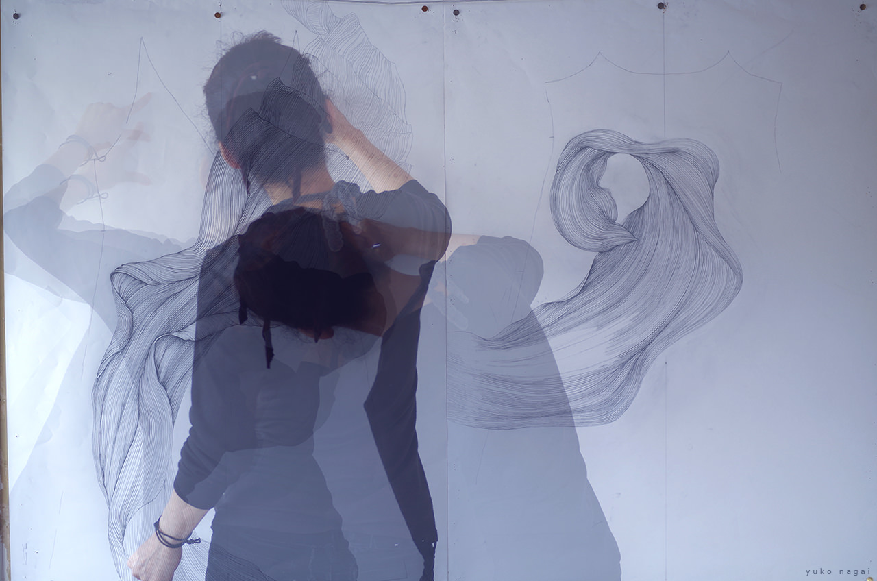 An artist working on her drawings.