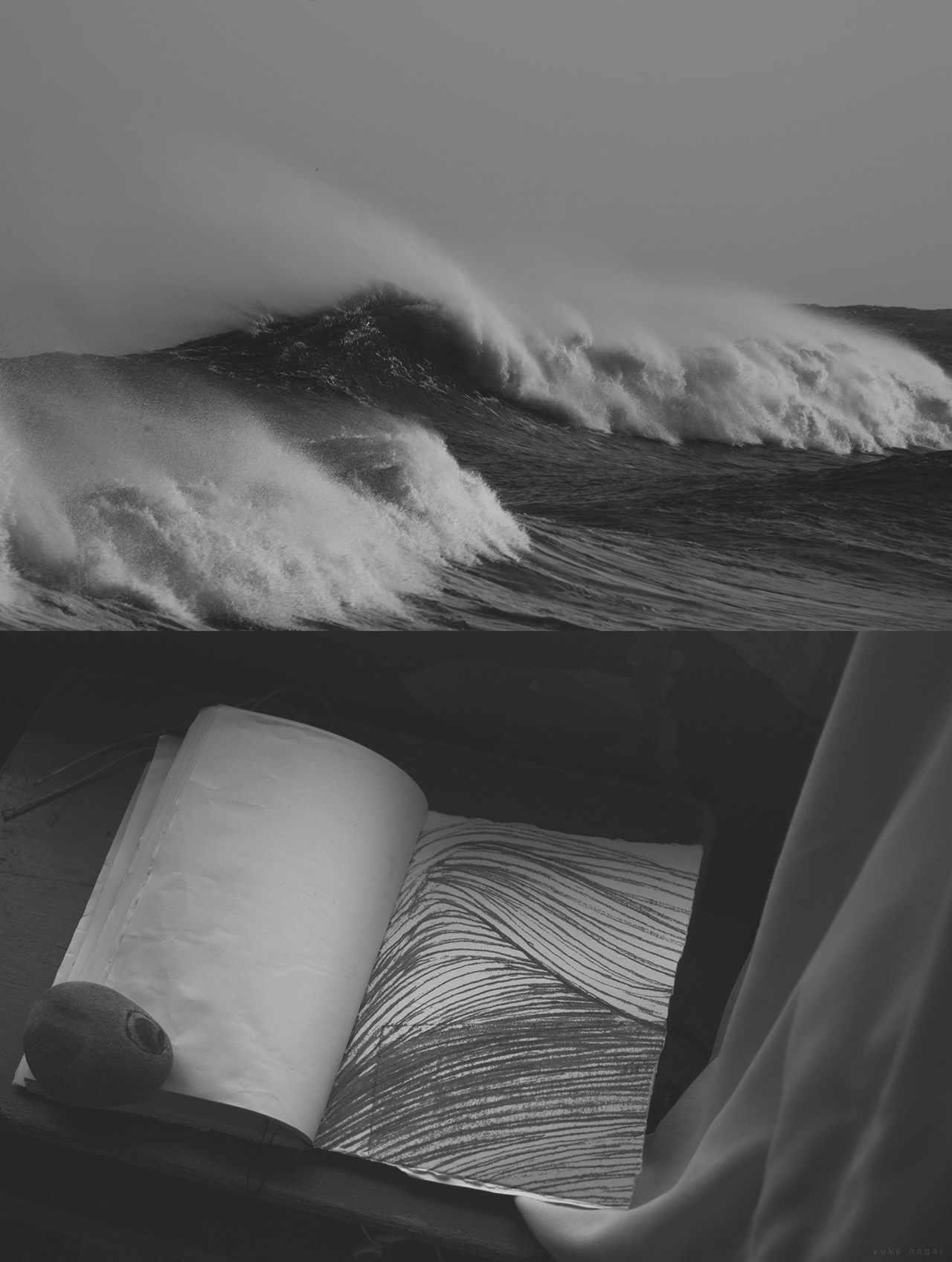 Ocean waves and a journal with a drawing.