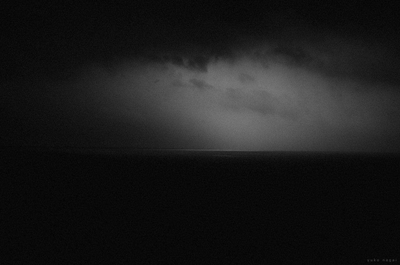 Dark clouds over sea.