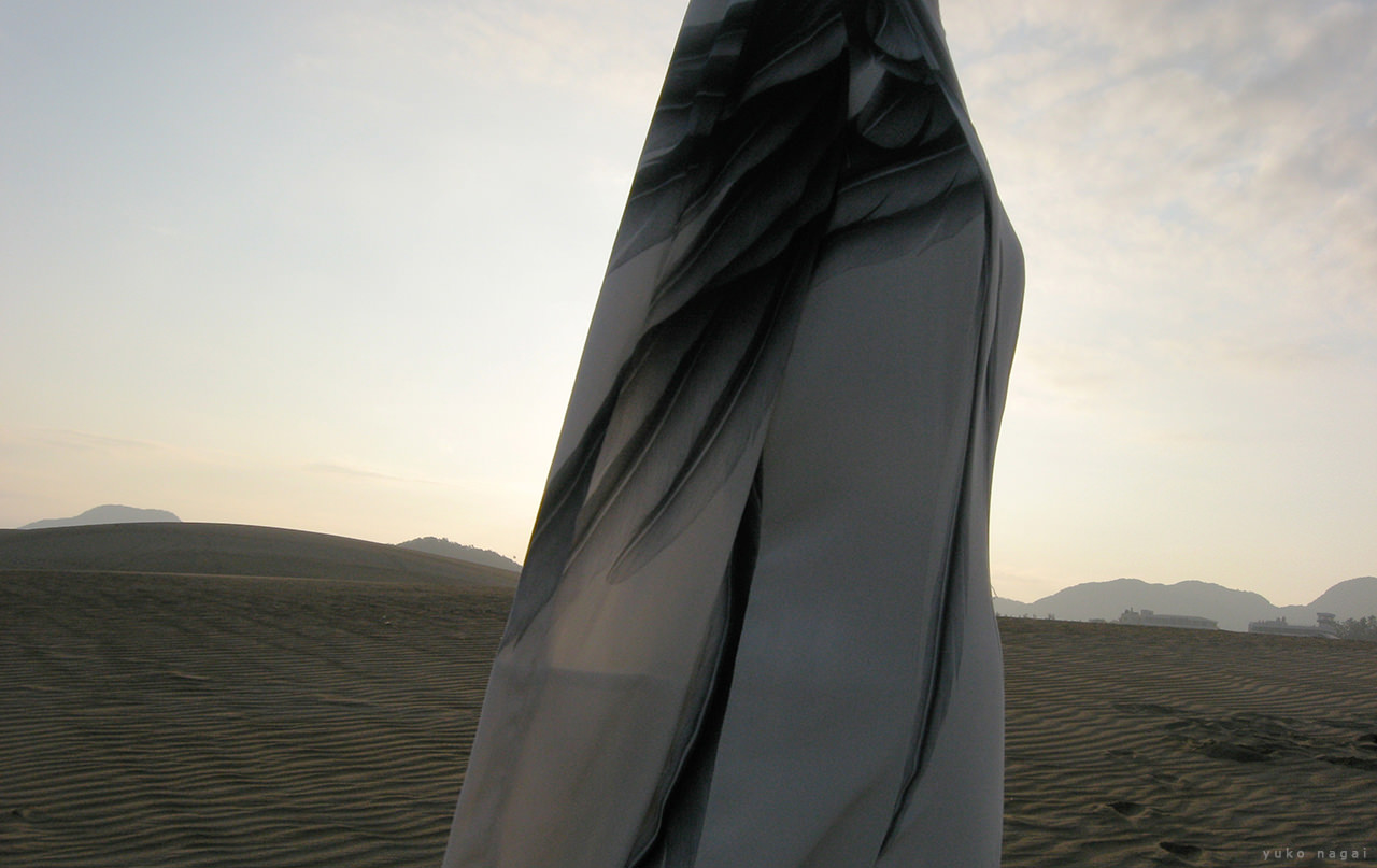 A hand painted dress on dune.