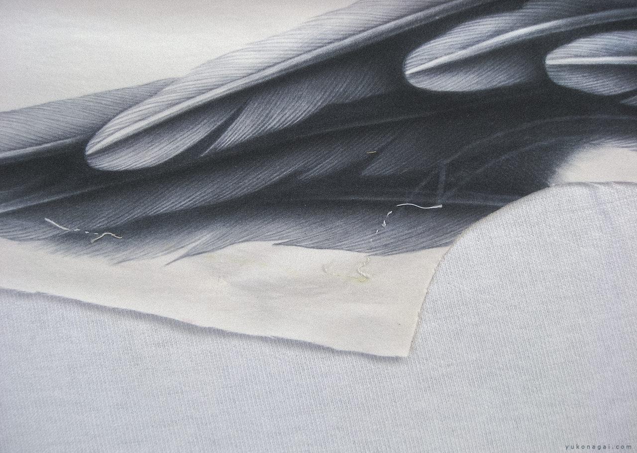 A wing drawn on a dress.
