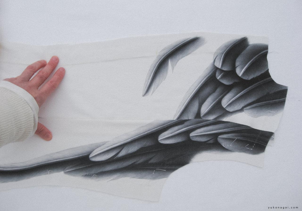Artist's hand and an artwork.