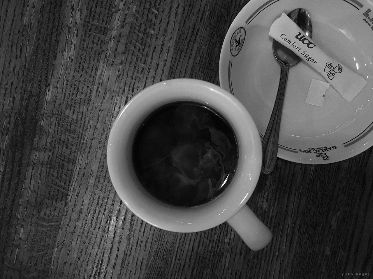 A coffee cup with sugar.