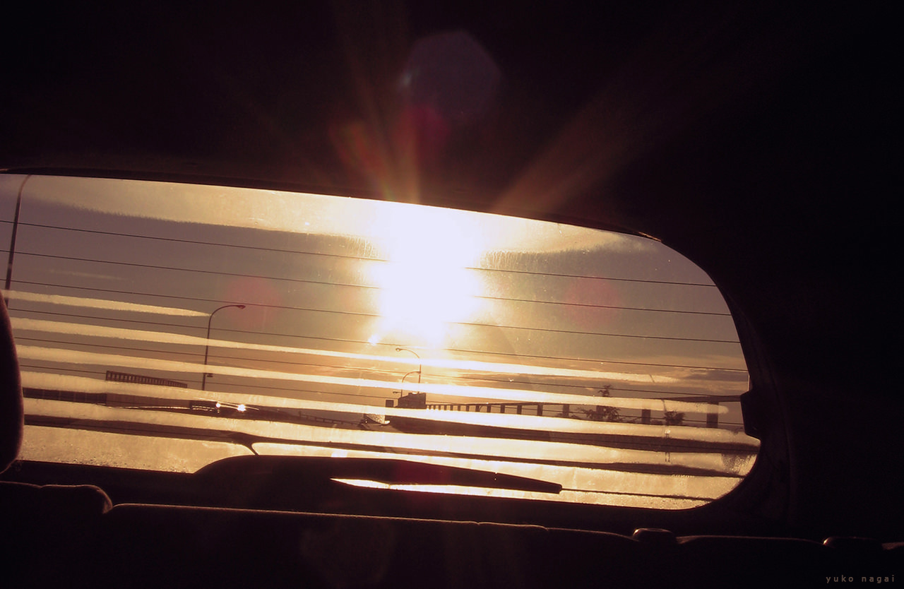 Automobile rear window at sun rise.