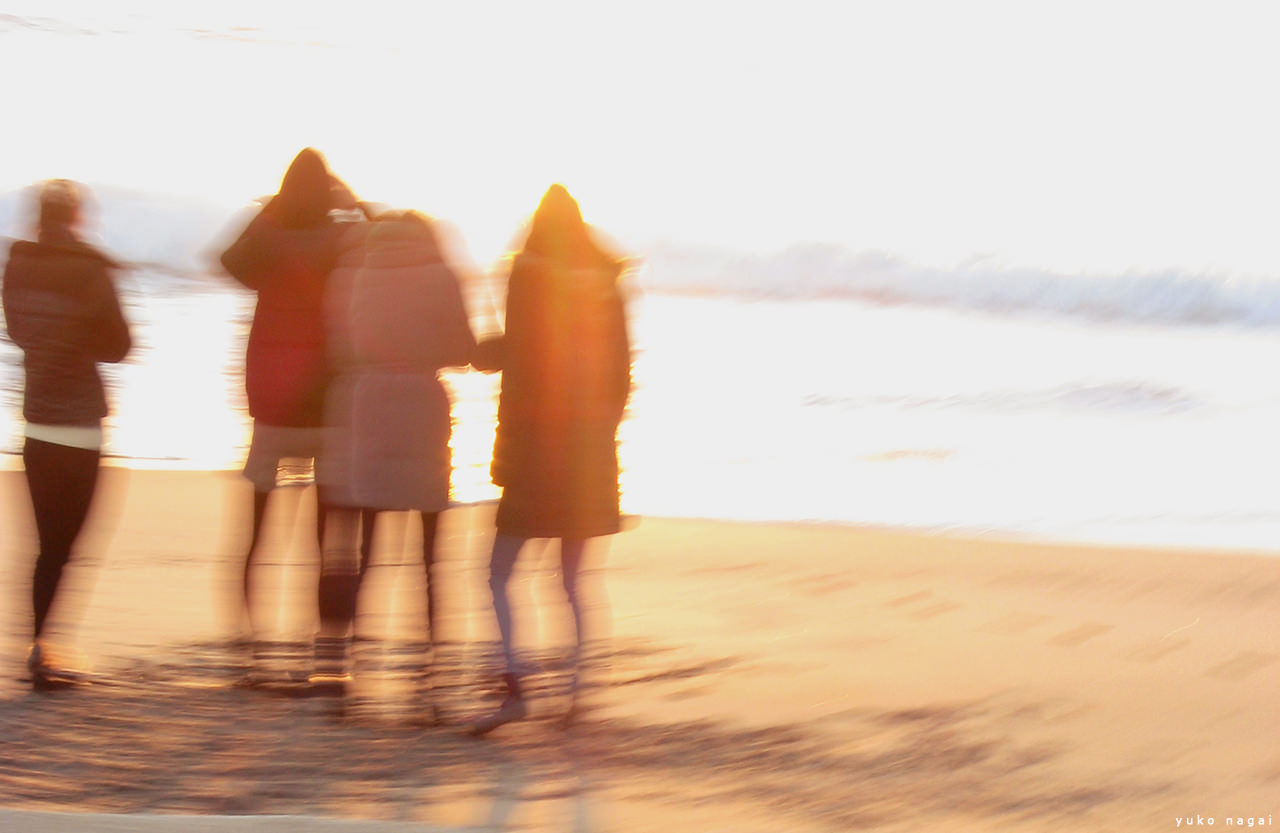 Girls on the shore at sun rise.
