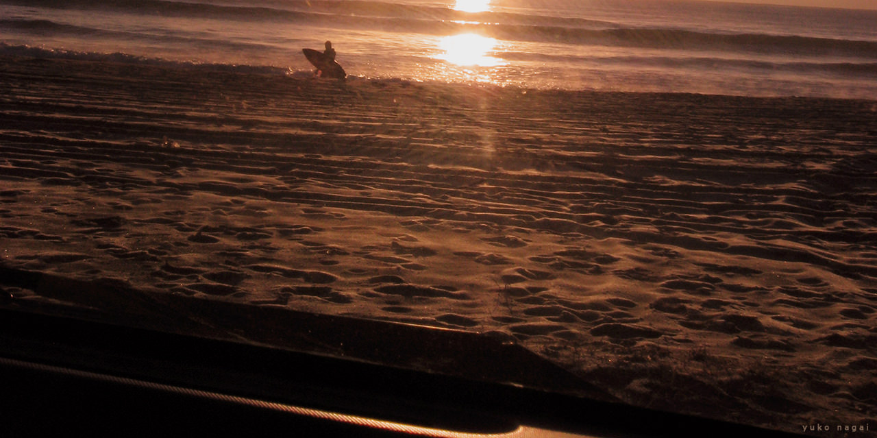 A surfer at sun rise.